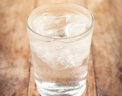 Glass of water on table - Reverse Osmosis Benefits
